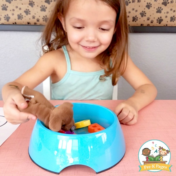 girl playing the alphabet puppy chow game for kids