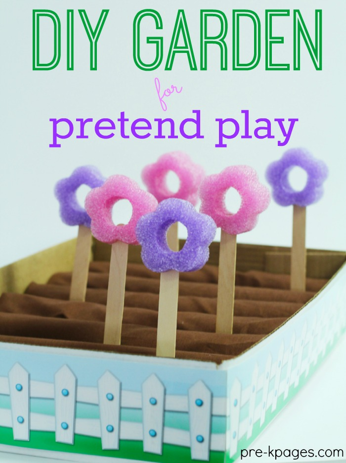 Play garden made with foam flowers, cloth dirt, and a box garden.