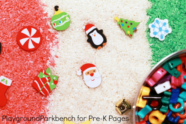Christmas Sensory Bin of colored rice and materials