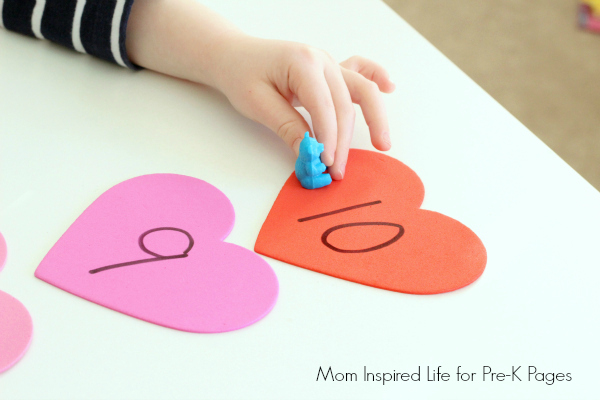 preschooler playing valentines day counting game