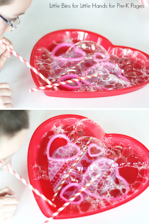 Kid Blowing Bubbles into a heart shaped dish