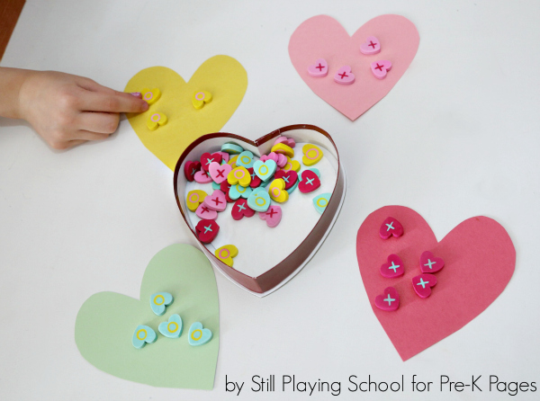 hand sorting hearts for Valentine's Day Activity