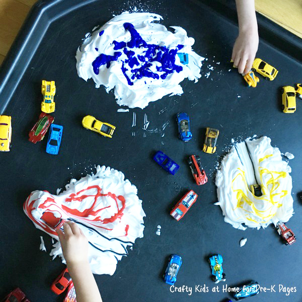 cars playing in shaving cream with paint