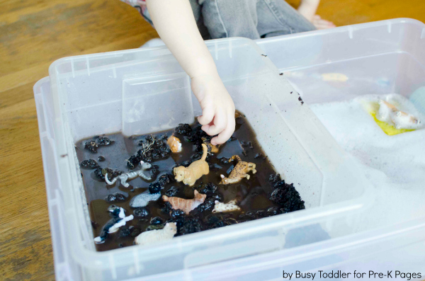 pet sensory bin of dirty water with toy pets