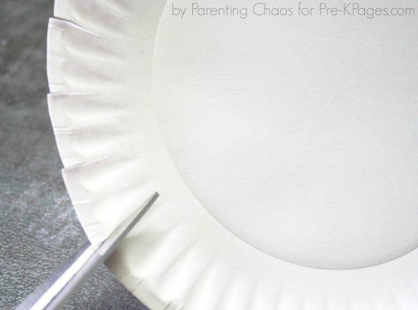 scissors cutting paper plate