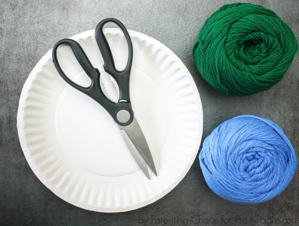 paper plate, scissors and yarn for earth day craft