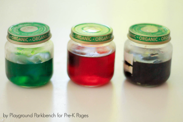 three jars of colored water for color mixing activity