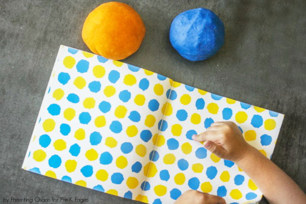 little blue little yellow book and two balls of playdough