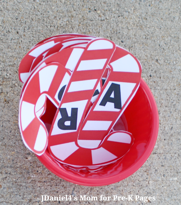 candy cane letters in a red bucket for game