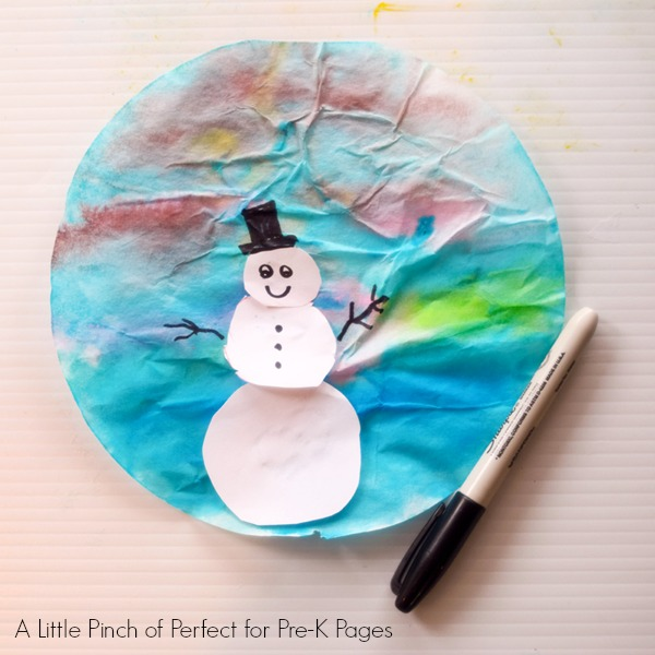 painted coffee filter with snowman on it