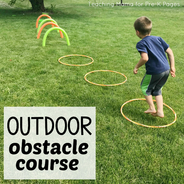 Kid jumping into hula hoop in outdoor obstacle course for preschoolers