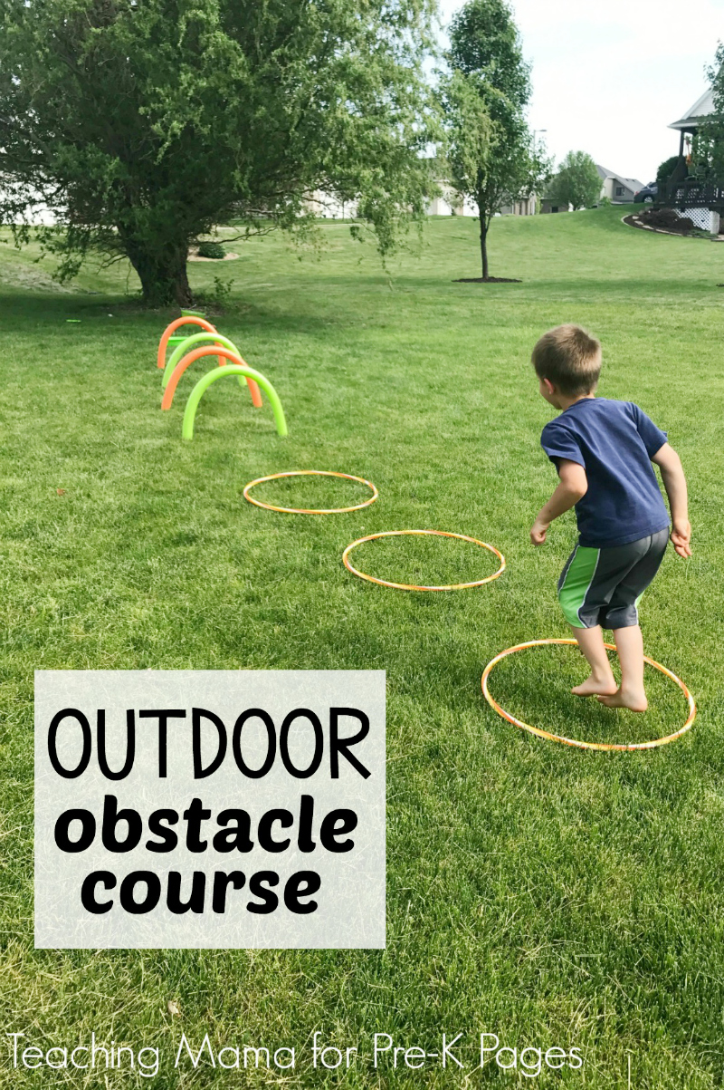 Kids jumping through hoops in outdoor obstacle course