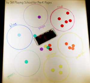 sorting colors on light table pre-k
