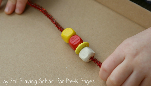 pipe cleaner with beads strung on it
