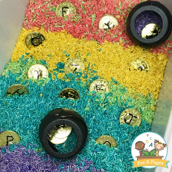 rainbow rice sensory bin with gold coins